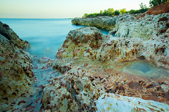 Hiding (D J Millard) Tags: east point darwin long exposure water rocks calm tranquil morning clear