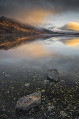 Moments in Mystery (Vemsteroo) Tags: uk morning blue light cloud mountains reflection skye water beautiful sunrise canon landscape island dawn scotland rocks isleofskye clarity 5d loch cuillins westernisles mkiii sligachan circularpolariser ndgrad 24mmtse leefilters lochsligachan