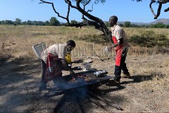 10075456 (wolfgangkaehler) Tags: africa travel people cooking breakfast tomato person bacon potatoes bush african sausage safari potato zambia chefs fritters southernafrica 2016 zambian southluangwanationalpark