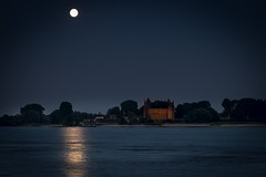 What the night brings us (marielledevalk) Tags: sky moon holland castle water netherlands dutch night river landscape evening outdoor horizon full fullmoon