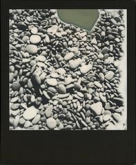 Pebbles at Reynisfjara (sycamoretrees) Tags: film beach analog polaroid iceland pebbles 600 integral slr680 sland impossible reynisfjara reynisdrangar instantfilm blackframe integralfilm bw600 blackframeedition marianrainerharbach bw600201602