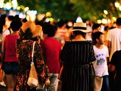 Women with Hats (katushang) Tags: china street city people color heilongjiang female night daylight nikon women colorful hats nightscene  fareast manualfocus afterdark harbin helios dx haerbin  helios402   russianlens d5100 nikond5100 helios402n