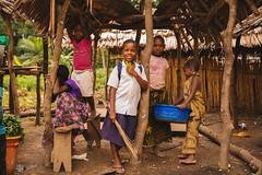 Girls Hanging Out At A Village Market in Kilosa, Tanzania (IFPRI-IMAGES) Tags: ifpri tanzania kilosa children girls smile pose group village community sisters friends young schoolchildren market striking kids
