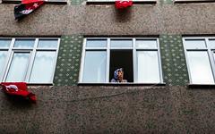 IMG_0674.JPG (esintu) Tags: window woman flag rally protest photojournalism istanbul yenikapi turkey