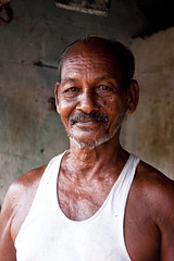 Vest, Connemara Market, Trivandrum, Kerala, India (MJ Reilly) Tags: city portrait india man closeup work nikon indian kerala kind vest trivandrum trader d90 thiruvananthapuram msrket