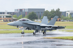 On land and water Boeing F/A-18F Super Hornet (Patcard) Tags: wet water puddle aircraft military united kingdom super landing hornet boeing f18 usn farnborough armed unitedstatesnavy fa18f amraam aim120c fia16