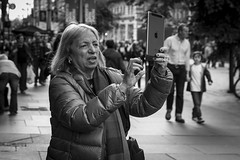 Tabletography (Leanne Boulton) Tags: life street city uk light shadow portrait people urban blackandwhite bw woman white black detail texture apple monochrome face female canon photography mono scotland living blackwhite photographer natural humanity bokeh outdoor expression glasgow candid culture streetphotography streetlife scene depthoffield human shade portraiture 7d society tablet tone facial candidportrait ipad candidstreetphotography