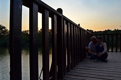 **Lazy afternoon (Despina Titoni) Tags: couple us love romantic kiss lazy afternoon sunset nature natural light sky colorful wooden deck lines water dam green trees reflection new project summer 2016 nikond3100 greek photographer greece thessaloniki together
