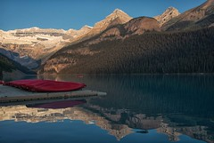 Beginning of a New Day (dbushue) Tags: morning lake canada mountains nature sunrise reflections landscape dawn nikon shadows canoes alberta banffnationalpark canadianrockies 2014 victoriaglacier lakelouis dailynaturetnc14 dailynaturetnc15
