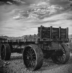 Power Wagon (magnetic_red) Tags: blackandwhite wagon nevada oldwest miningequipment steelwheels dramticsky