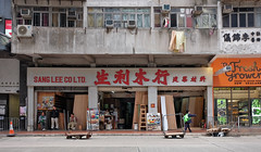 """""""a shop of yesteryear and a schoolboy passing by"""" (hugo poon - one day in my life) Tags: shop architecture hongkong laundry vanishing x70 schoolboy yesteryear prewar wanchai queensroadeast sanglee windowtypeac"""