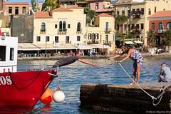 Helping Hand (Manos Migomis) Tags: fujifilmxt1 fujinonxf35f2rwr chania crete greece morning oldtown streetphotography sea boat buildings outdoor