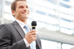 Businessman Speaking With a Microphone (FirmanIkhsan) Tags: 30something adult adultsonly attendee attractiveman business businessman businessperson caucasian conference confidence copyspace determination handsome happy horizontal leadership lecture lowangle male man menonly microphone officeworker oneman oneperson people professional smiling speaker speech success suit toothysmile waistup welldressed whitecollarworker