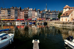 dark mysterious waters of the Vieux Bassin (Old Port) against the sun-drenched yachts, slate and stone of Honfleur, Normandy, France (grumpybaldprof) Tags: vieuxbassin oldharbour honfleur normandie normandy france quaistecatherine quaiquarantaine quai quaistetienne stecatherine lalieutenance quarantaine water boats sails ships harbour historic old ancient monument picturesque restaurants bars town port colour lights reflection architecture buildings mooring sailing stone collombage halftimbered yachts sun sundenched darkwater oldport yellow blue colours vibrancy intensty reflections contrast slate beige shakes wood timber piers cloudlesssky deepblue vacation holiday summerholiday relax sunshine