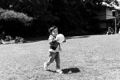 Yoyogi Park, Tokyo (fabiolug) Tags: kid child playing ball smile smiling yoyogipark park people street streetphotography tokyo japan japanese asia leicammonochrom mmonochrom monochrom leicamonochrom leica leicam rangefinder blackandwhite blackwhite bw monochrome biancoenero 35mmsummicronasph 35mmf2summicronasph summicronm35mmf2asph summicron35mmf2asph 35mm summicron leicasummicron leica35mm