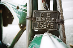 """""""15645"""" (Eric Flexyourhead (shoulder injury, slow)) Tags: vancouver canada britishcolumbia bc chinatown unionstreet city urban detail fragment bike bicycle licenseplate numberplate old vintage rusting rusty corroded corrosion shallowdepthoffield ricohgr"""