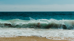 Swallowed (emmeffess) Tags: ocean beach water waves blue sunny surf crash seafoam