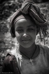 Young Ethiopian Woman (Peraion) Tags: ethiopia woman blackandwhite bw scarf smile cross christian africa
