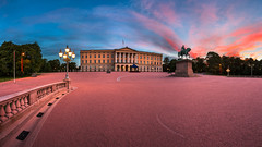 Panorama of the Royal Palace and Statue of King Karl Johan at Sunrise, Oslo, Norway (ansharphoto) Tags: park old city morning travel blue sky urban panorama sculpture horse building castle history monument yellow oslo norway statue skyline architecture facade sunrise garden square landscape dawn lights town twilight europe king european cityscape view capital culture royal landmark palace illuminated norwegian monarch karl residence scandinavia johan scandinavian slottet slottsparken