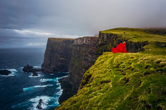 Mighty Mykines (West Leigh) Tags: ocean travel cliff storm landscape flow island coast fly wind time north dream atlantic wanderlust explore experience remote inspire faroeislands reddress wander discover mykines wandress