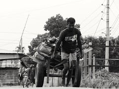 A hard working man pulling heavy loads (Rahat khan4) Tags: street portrait man heavy bangladesh loads balckwhite netrokona manportrait streetsofbangladesh