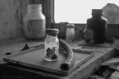 There is something in the bottle (rvanhegelsom) Tags: europe old urban urbex urbanexploration urbexworld urbxtreme rural portugal abandoned derelict hospital sanatorium indoors indoor bottle glass