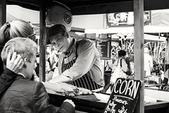 Pick a corn any corn... [ In Explore 11-08-2016 ] (sawyersource) Tags: streetphotography street blackwhite blackandwhite bw d7200 nikon 35mm people food streetfood cart foodmarket market southbank waterloo london gb britain uk corn hands son boy londoner flavours butter bushradio radio apron hat flatcap bbq grill pick takeaway inexplore explore explored mother hand hold affection