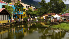 1T9A2400 (Victor Mitri) Tags: wooden woodenbridge river lake reflection town colors brdige mountains clouds raining buildings red beautiful urbain malaysia langkawi green trees