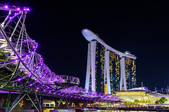 Helix Bridge and Marina Bay Sand Hotel at night time landmark in Singapore. (Nuttawut Uttamaharad) Tags: city travel bridge light sky urban building tower tourism water beautiful skyline architecture modern night skyscraper marina river landscape asian hotel bay singapore asia cityscape cross riverside famous landmark scene tourist casino structure resort business tropical destination helix oriental sands attraction
