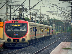 Indian Railways : ERs' own BEML EMU rushes towards Howrah under overcast sky ! (Clicker Purnava) Tags: road railroad sky india beautiful beauty sport electric contrast speed train landscape ir amazing fantastic track day afternoon er cloudy outdoor indian awesome ngc transport rail railway wb rails vehicle emu locomotive serene local passenger incredible eastern railways bengal railfan conventional outstanding catenary iri westbengal howrah lifeline mps indianrailways natgeo cloudyday bwn railfanning indiatravel dkae irfca railfans incredibleindia trainwatchers multipleunit hwh dankuni barddhaman indialove easternrailway ferroequinologist worldtrains discoveryindia trainsworldwide railwaylovers