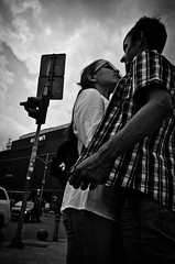 Look Me in the Eyes and Hold Me (stimpsonjake) Tags: nikoncoolpixa 185mm streetphotography bucharest romania city candid blackandwhite bw monochrome love romance couple hug embrace young guy girl holdme youth