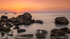 sunrise konnos bay (stavros karamanis) Tags: sunrise sun morning water sea seaside seascape bay beach coast sky skylovers colours boat rock canonphotography canonusers canon dslr t3i tokina 1116mm f28 dxii konnos paralimni famacusta cyprus longexposure leefilters hoya bigstoper outdoor ngc