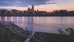 omaha - evening skyline - long exposure (laughlinc) Tags: 2016 city cityscape dusk laughlinc longexposure mutipleexposure nebraska night nikon1755mm24 nikond7200 omaha river riversedgepark riverfront skyline tomhanafanriversedgepark nikon
