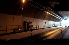 Tunnel worker (Roving I) Tags: workmen workers hardhats helmets highways road tunnels entrances lights rails langco vietnam