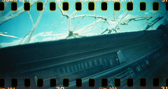 (No Stone Unturned Photography) Tags: film broken yard 35mm lomo lomography cross kodak slide panoramic 1999 1600 dash rocket junkyard windshield cracks expired salvage processed hiddenvalley sprocket sprocketholes