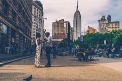 Empire Conversation (Mindset  Visuals) Tags: street city newyorkcity portrait sky urban newyork color colour colors beautiful fashion clouds portraits buildings photography frozen amazing colours shadows skyscrapers pavement geometry candid awesome rustic grain captured streetphotography special photograph portraiture views empire stunning second empirestatebuilding conversation geometrical grainy moment capture talking quick incredible viewing streetview captures newyorklife streetshot urbanlife followme candidportrait frozenintime urbanliving f4f specialmoment youngphotographer mycapture explorenyc empirestateofmind nycexplore explorenewyork millesecond nycexploration