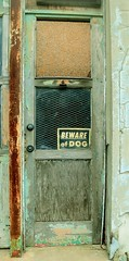 Beware of Dog (slammerking) Tags: abandoned kingmanks sign peelingpaint door window forgotten decay weatherd