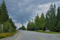 Storm (Whistler Whatever) Tags: dark whistler blueberry green street approaching road storm trees summer clouds outside sign windy