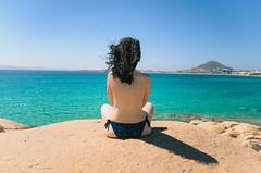 Over the Horizon (sotiris_tzatzakis) Tags: sea seascape portrait back view horizon blue coast rocks female model naked sexy nikon d5100 greece naxos color outdoors