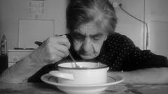 The Most splendid soup (dzepni_oktavo) Tags: nana old lady granny black white eating soup sad lonely melancholic aged people emotive portrait