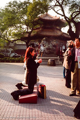Kneeling to Pray (gwpics) Tags: forbiddencity beijing chinese building religion people girl streetphotography praying prayer buddhism china belief faith female film gugong imperialpalace person socialcomment socialdocumentary society strasenfotograpfie lifestyle streetpics    incense