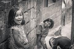 Girls power! (vincent.lecolley) Tags: children group portrait monochrome blackandwhite girls asian philippines lifestyle street documentary photojournalism boy