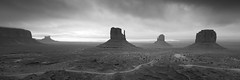 Monuments I (Adam Clutterbuck) Tags: usa monument valley mittens formations mono bw panorama panoramic utah landscape blackandwhite