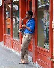 Red Hot & Blue (WalrusTexas) Tags: blue red portrait musician orange man reflection neworleans saxophone nawlins challengegamewinner