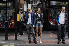 body language and buses (jonron239) Tags: england unitedkingdom man woman boy girl blond brunette smartphone gesture expression symmetry bus foldedarms bodylanguage leatherjacket hotpants richmond