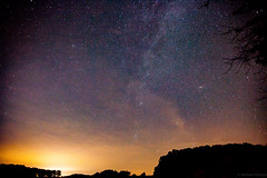 The night sky - Minneapolis in the distance (michaelraleigh) Tags: minnesota night canon stars galaxy astrophotography serene secluded milkyway 2035mm f28l