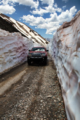 Snowy Trail (Scott Sanford Photography) Tags: colorado coloradotrails offroad travel trip trailriding outdoor mountains rockymountains sanjuanmountains ophirpass snow sun sky clouds toyota tacoma canon eos 6d ef2470mmf28lusm topazlabs summer vacation trd exploring explorer