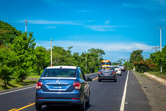 We were continually passed by a convoy of 60 vehicles being hand delivered to the dealership in Managua.