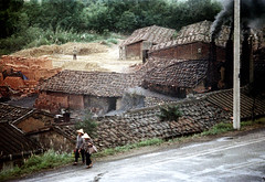 32-847 (ndpa / s. lundeen, archivist) Tags: nick dewolf nickdewolf 32 reel32 color photographbynickdewolf 1970s 1972 fall film 35mm winter republicofchina taiwan taiwanese china chinese road highway people women hats conicalhats traditionalhats buildings houses homes chimney chimneys smoke smoking smokingchimney smokingchimneys roofs rooftops 1973