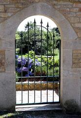 Bucolic gate (patrick_milan) Tags: garden jardin street flowers rue fleurs banc bench plouguin